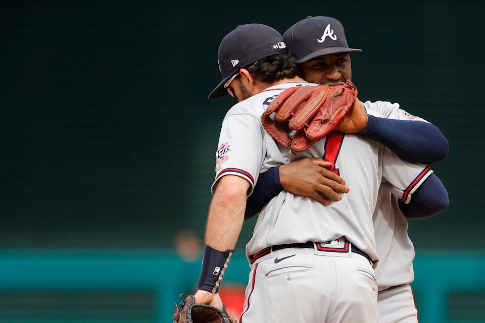Ozzie Albies and Dansby Swanson celebrate a win against the Nationals.