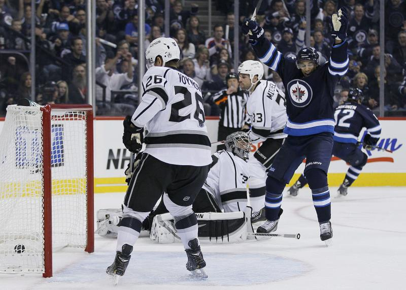 Winnipeg Jets' Evander Kane, right, and Olli Jokinen, background, celebrate Jokinen's goal against the Los Angeles Kings during the second period of an NHL hockey game in Winnipeg, Manitoba, on Friday, Oct. 4, 2013. (AP Photo/The Canadian Press, John Woods)