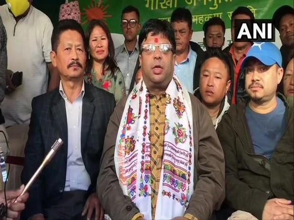Roshan Giri of Gorkha Janmukti Morcha faction speaking to reporters on Sunday. [Photo/ANI]