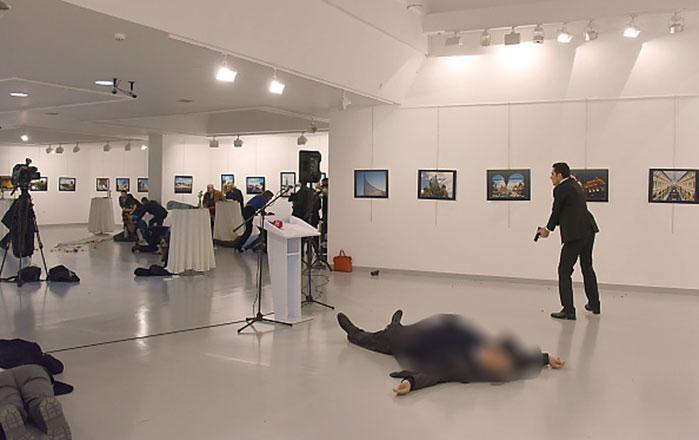 <p>Andrey Karlov, the Russian ambassador to Turkey, lies on the floor after being shot by a gunman (R) during an attack at a public event in Ankara. Photo:  STRINGER/AFP/Getty Images</p>
