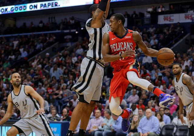 Apr 11, 2018; New Orleans, LA, USA; New Orleans Pelicans guard Rajon Rondo (9) passes as San Antonio Spurs forward LaMarcus Aldridge (12) defends during the first quarter at the Smoothie King Center. Mandatory Credit: Derick E. Hingle-USA TODAY Sports TPX IMAGES OF THE DAY