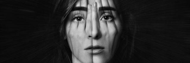 Double exposure photo of woman covering her face.