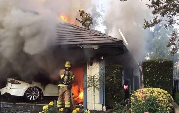 Firefighters battle a blaze sparked by a Tesla in Lake Forest, Calif., on Aug. 25, 2017. (Orange County Fire Authority)