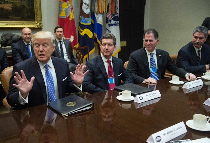 US President Donald Trump (L) meets with business leaders in the Roosevelt Room at the White House on January 23, 2017 (AFP Photo/NICHOLAS KAMM)
