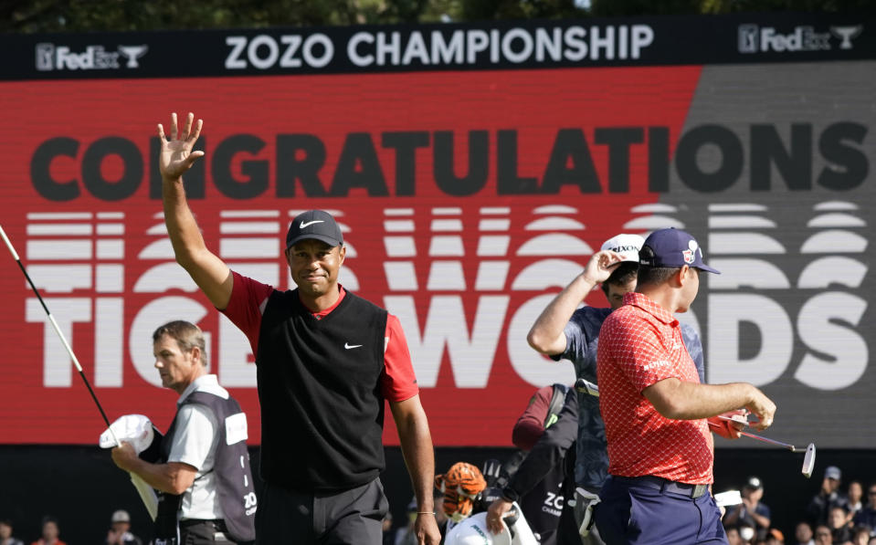 Tiger Woods of the United States celebrates after winning the Zozo Championship PGA Tour at the Accordia Golf Narashino country club in Inzai, east of Tokyo, Japan, Monday, Oct. 28, 2019. (AP Photo/Lee Jin-man)