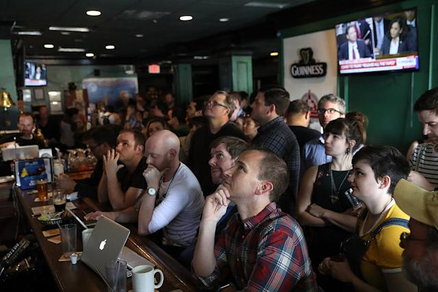 <p>Patrons at Duffy's Irish Restauran and Bar watch former FBI Director James Comey testify before the Senate Intelligence Committee June 8, 2017 in Washington, D.C. (Win McNamee/Getty Images) </p>