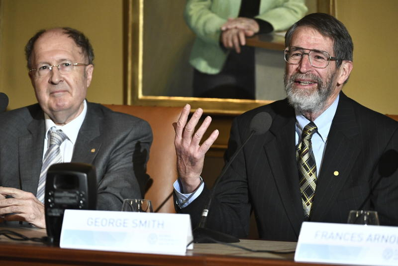 Gregory P. Winter, 2018 Nobel laureate in Chemistry, left, and Professor George P. Smith, 2018 Nobel laureate in Chemistry take part in a press conference at the Royal Academy of Science in Stockholm, Sweden, Friday Dec. 7, 2018. (Claudio Bresciani/TT via AP)