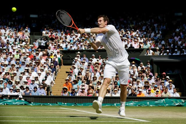 LONDON, ENGLAND - JULY 07: Andy Murray of Great Britain plays a backhand during the Gentlemen's Singles Final match against Novak Djokovic of Serbia on day thirteen of the Wimbledon Lawn Tennis Championships at the All England Lawn Tennis and Croquet Club on July 7, 2013 in London, England. (Photo by Anja Niedringhaus - Pool/Getty Images)