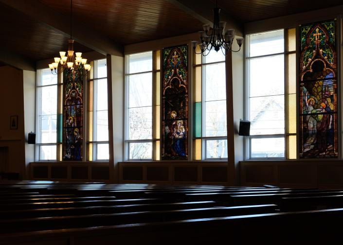 Light shines through windows onto the empty pews at St. Mary's Church in Washingtonville, New York, after the cancellation of Sunday Mass due to the new coronavirus. (AP Photo/Paul Kazdan)