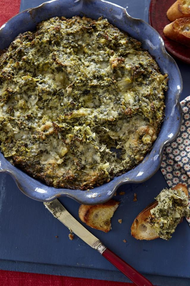 "<p><b>Recipe: <a href=""https://www.southernliving.com/syndication/spinach-artichoke-dip-2"">Spinach Artichoke Dip</a></b></p> <p>This classic recipe doesn't need frills to be a favorite. With just seven ingredients, you still have the best dip on the lineup.</p>"