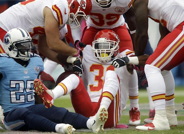 Kansas City Chiefs' Marcus Cooper (31) is helped up after recovering a fumble by the Tennessee Titans in the end zone for a touchdown in the first quarter of an NFL football game on Sunday, Oct. 6, 2013, in Nashville, Tenn. At left is Titans' Darius Reynaud (25). (AP Photo/Wade Payne)