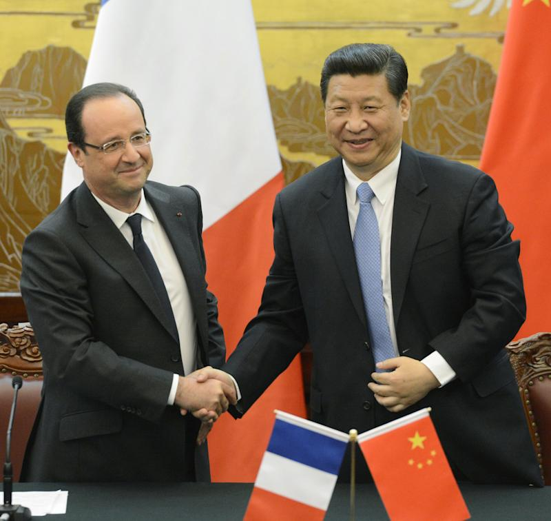 China, France vow to promote 'multipolar' world