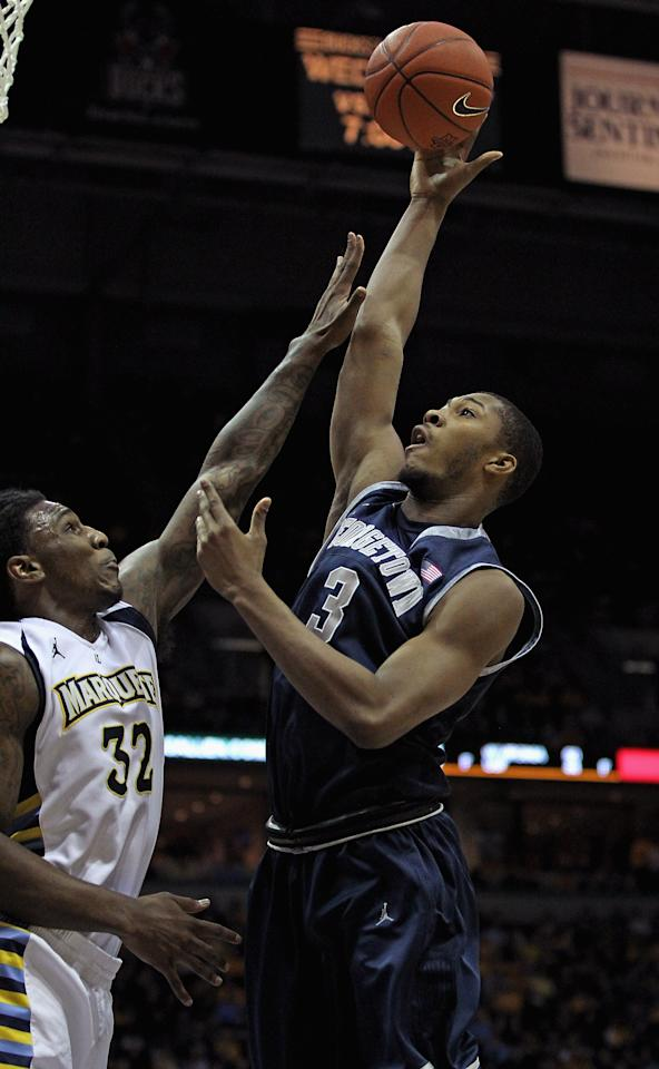 MILWAUKEE, WI - MARCH 03: Mikael Hopkins #3 of the Georgetown Hoyas shoots over Jae Crowder #32 of the Marquette Golden Eagles at the Bradley Center on March 3, 2012 in Milwaukee, Wisconsin. Marquette defeated Georgetown 83-69.  (Photo by Jonathan Daniel/Getty Images)