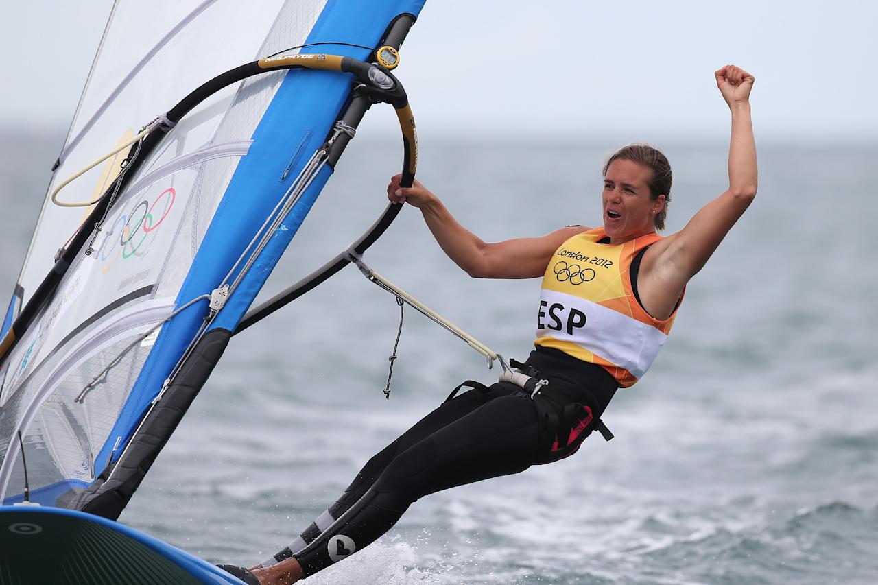 WEYMOUTH, ENGLAND - AUGUST 07:  Marina Alabau Neira of Spain celebrates winning the gold medal in the RS:X Women's Sailing on Day 11 of the London 2012 Olympic Games at the Weymouth & Portland Venue at Weymouth Harbour on August 7, 2012 in Weymouth, England.  (Photo by Clive Mason/Getty Images)