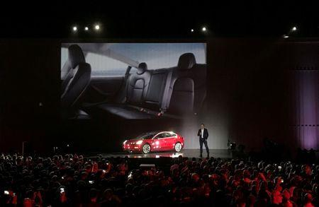 FILE PHOTO: Tesla Chief Executive Elon Musk introduces one of the first Model 3 cars off the Fremont factory's production line during an event at the company's facilities in Fremont, California, U.S. on July 28, 2017.     REUTERS/Alexandria Sage/File Photo