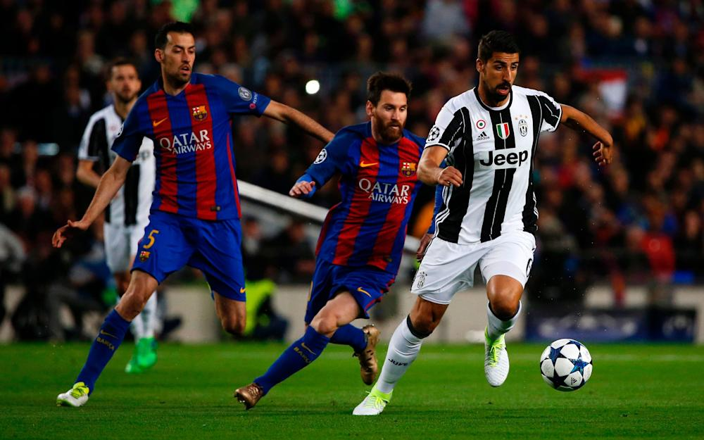 Barcelona's Argentinian forward Lionel Messi (C) followed by Barcelona's midfielder Sergio Busquets - Credit: AFP