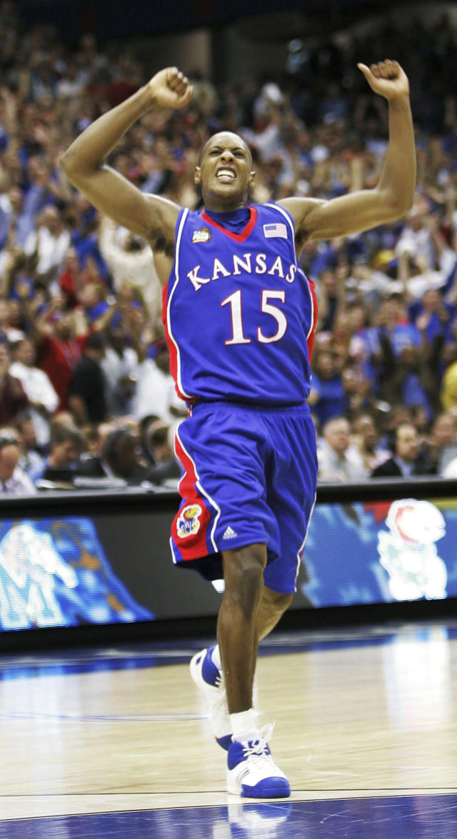FILE - In this April 7, 2008, file photo, Kansas' Mario Chalmers (15) celebrates after hitting a three point shot to take the game into overtime against Memphis during the championship game at the NCAA college basketball Final Four in San Antonio. Chalmers 3-pointer with 2.1 seconds left in regulation pushed the game into overtime, and the Jayhawks grinded it out from there for a 75-68 victory over Memphis in one of the best title games in recent memory. (AP Photo/Eric Gay)