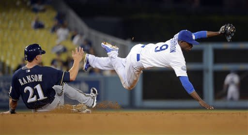Milwaukee Brewers' Cody Ransom, left, is forced out at second by Los Angeles Dodgers shortstop Dee Gordon as he takes high throw after Carlos Gomez bunted into a fielder's choice during the sixth inning of their baseball game, Wednesday, May 30, 2012, in Los Angeles. (AP Photo/Mark J. Terrill)