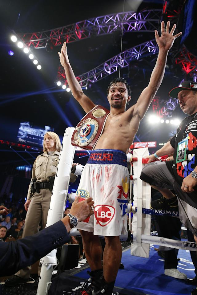 Manny Pacquiao of the Philippines acknowledges the crowd just after his unanimous decision victory over Timothy Bradley during their WBO World Welterweight championship boxing match, Saturday, April 12, 2014, at The MGM Grand Garden Arena in Las Vegas. (AP Photo/Eric Jamison)