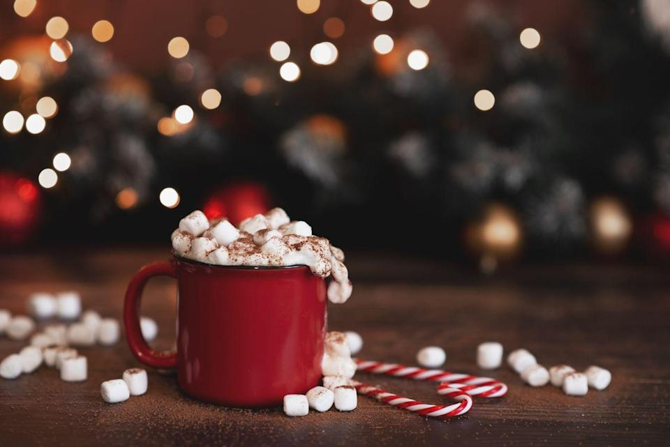 """<p>If the kids go crazy for a cup of cocoa, they'll really love this interactive Christmas activity. Make a big batch of hot chocolate and set out plenty of toppings—think marshmallows, whipped cream, sprinkles, and crushed peppermints—then let everyone in the family go to town. </p><p><em>Learn how to set up a hot chocolate bar at <a href=""""https://www.howsweeteats.com/2014/11/lindt-chocolate-hot-chocolate-bar/"""" rel=""""nofollow noopener"""" target=""""_blank"""" data-ylk=""""slk:How Sweet Eats"""" class=""""link rapid-noclick-resp"""">How Sweet Eats</a>.</em></p><p><a class=""""link rapid-noclick-resp"""" href=""""https://www.amazon.com/Chocolatier-Chocolate-Gourmet-Canister-Servings/dp/B07PPPD1YZ/?tag=syn-yahoo-20&ascsubtag=%5Bartid%7C10072.g.34454588%5Bsrc%7Cyahoo-us"""" rel=""""nofollow noopener"""" target=""""_blank"""" data-ylk=""""slk:SHOP HOT COCOA POWDER"""">SHOP HOT COCOA POWDER</a></p>"""