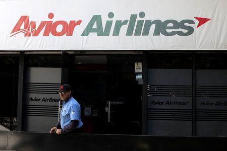 A security guard stands in front of an office of Avior Airlines in Caracas, Venezuela May 15, 2019. REUTERS/Manaure Quintero NO RESALES. NO ARCHIVES.