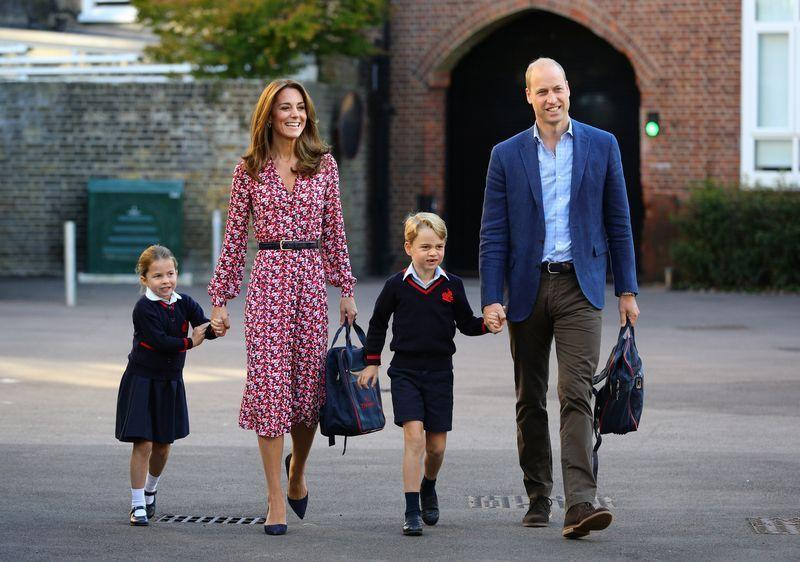 <p>The siblings hold hands with their parents, the Duke and Duchess of Cambridge. </p>