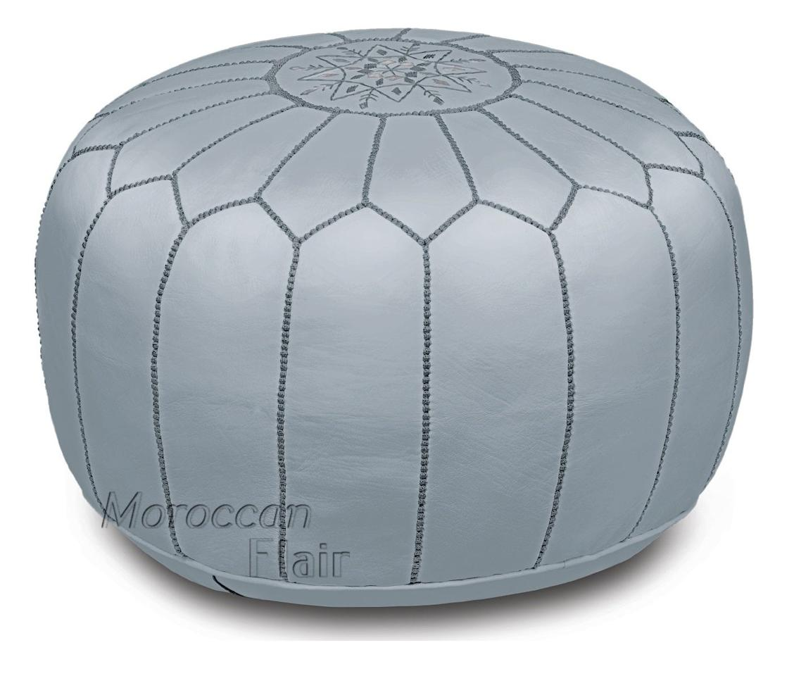 "<p><a href=""https://www.popsugar.com/buy/Moroccan-Flair-Leather-Moroccan-Pouf-Gray-505080?p_name=Moroccan%20Flair%20Leather%20Moroccan%20Pouf%20in%20Gray&retailer=amazon.com&pid=505080&price=180&evar1=casa%3Aus&evar9=46784503&evar98=https%3A%2F%2Fwww.popsugar.com%2Fphoto-gallery%2F46784503%2Fimage%2F46791570%2FMoroccan-Flair-Leather-Moroccan-Pouf-in-Gray&list1=shopping%2Camazon%2Cdecor%20shopping%2Chome%20shopping&prop13=api&pdata=1"" rel=""nofollow"" data-shoppable-link=""1"" target=""_blank"" class=""ga-track"" data-ga-category=""Related"" data-ga-label=""https://www.amazon.com/gp/product/B01N7WDT3B/ref=ppx_yo_dt_b_asin_title_o00_s00?ie=UTF8&amp;th=1"" data-ga-action=""In-Line Links"">Moroccan Flair Leather Moroccan Pouf in Gray</a> ($180)</p>"