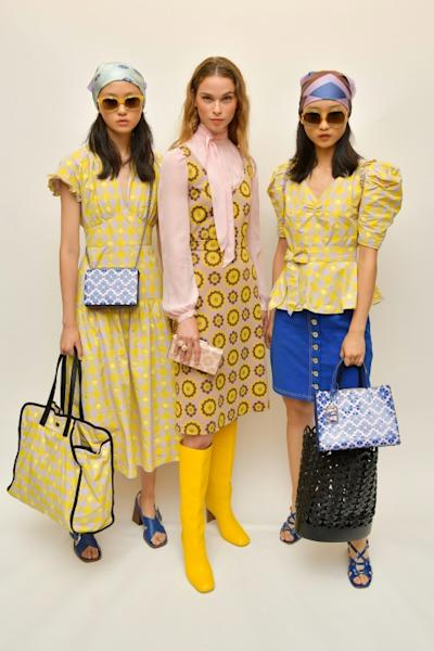 Kate Spade's spring/summer 2019 is one of pale lilac, hot pink, dark green, chartreuse, florals and print, with block-heeled sandals and knee-high boots, and liberal use of the spade symbol
