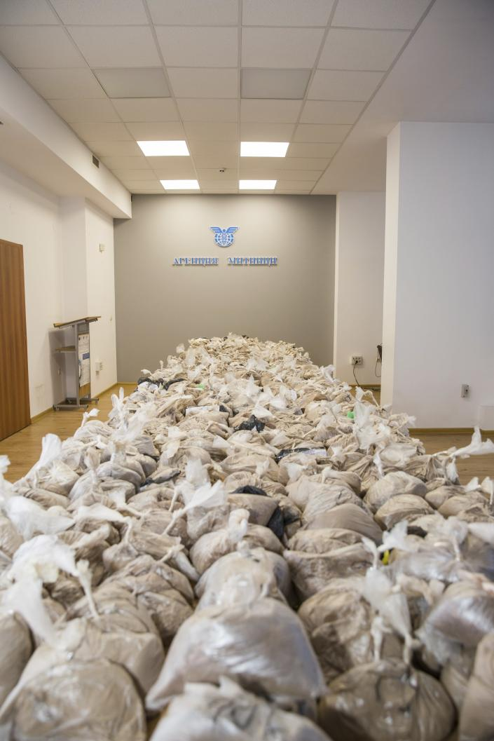 Photo released by Bulgarian Prosecutor's Office on Tuesday, Feb. 16 2021, shows packages of seized heroin from Iranian cargo in the Black Sea port of Varna. Bulgarian customs officials confiscated more than 400 kilograms (880 pounds) of heroin from a ship transporting goods from Iran. (Bulgarian Prosecutor's Office via AP)