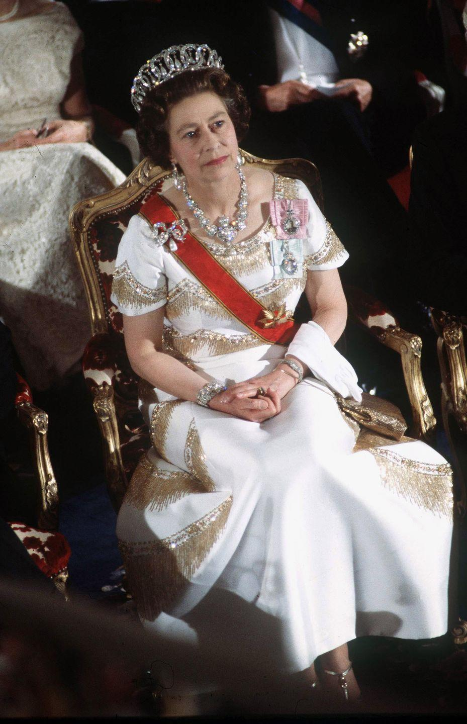 <p>The Queen's diamond and pearl looped tiara, worn here on May 22, 1978, is known as the Grand Duchess Of Vladimir Of Russia Tiara, and the matching necklace and earrings were originally a gift to Queen Victoria. The accompanying brooch, a bow of diamonds with a pearl drop, was given to Queen Mary on her wedding day.</p>