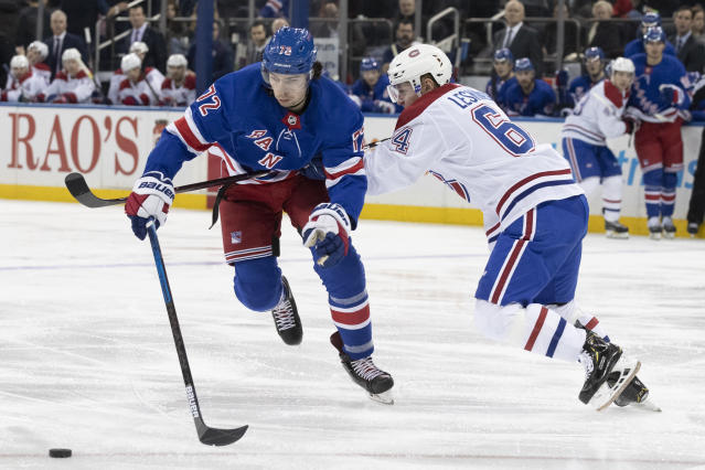 New York Rangers center Filip Chytil (72) is checked by Montreal Canadiens defenseman Otto Leskinen (64) during the second period of an NHL hockey game, Friday, Dec. 6, 2019, at Madison Square Garden in New York. (AP Photo/Mary Altaffer)