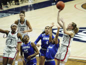 Connecticut guard Paige Bueckers, right, shoots against Seton Hall guard Mya Jackson (5) during the first half of an NCAA college basketball game Wednesday, Feb. 10, 2021, in Storrs, Conn. (David Butler II/Pool Photo via AP)