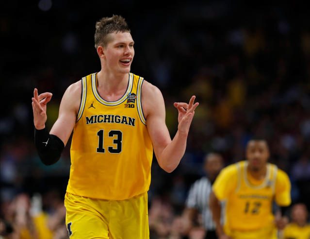 Michigan's Moritz Wagner has a monster game and a run-in with CBS broadcaster Bill Raftery during Saturday's Final Four win over Loyola Chicago. (AP)