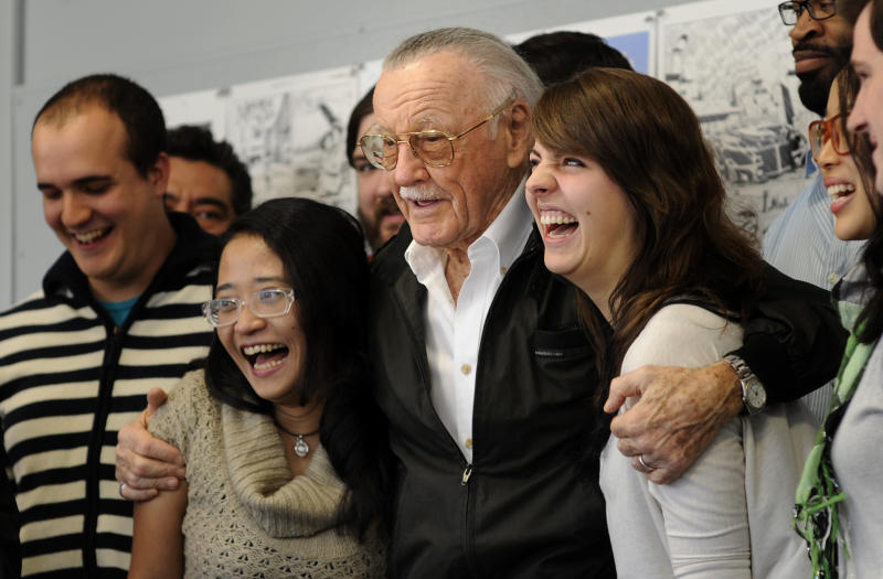 Legendary comic creator Stan Lee poses with students at the Savannah College of Art and Design while visiting the college to critique some of the work by graduate and undergraduate students in the sequential art program in Savannah, Ga., on Wednesday, Oct. 31, 2012. Lee, the 89-year-old co-creator of Spider-Man, dropped in on the school after being honored at the SCAD Savannah Film Festival. (AP Photo/Stephen Morton)