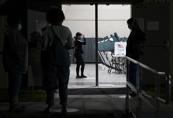 Voters wait outside Victory Houston polling station in Houston on Friday, Oct. 30, 2020. The location was one of the Harris County's 24-hour locations. ( Elizabeth Conley/Houston Chronicle via AP) ORG XMIT: TXHOU104