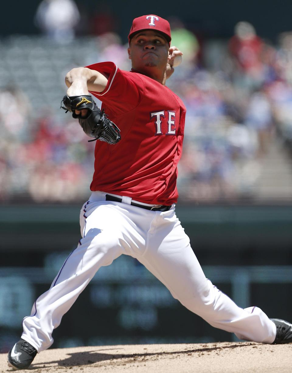 Texas Rangers starting pitcher Wandy Rodriguez throws during the first inning of a baseball game against the Boston Red Sox, Sunday, May 31, 2015, in Arlington, Texas. (AP Photo/Brandon Wade)