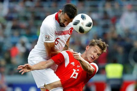 Soccer Football - International Friendly - Russia vs Turkey - VEB Arena, Moscow, Russia - June 5, 2018 Turkey's Okay Yokuslu in action with Russia's Aleksei Miranchuk REUTERS/Sergei Karpukhin