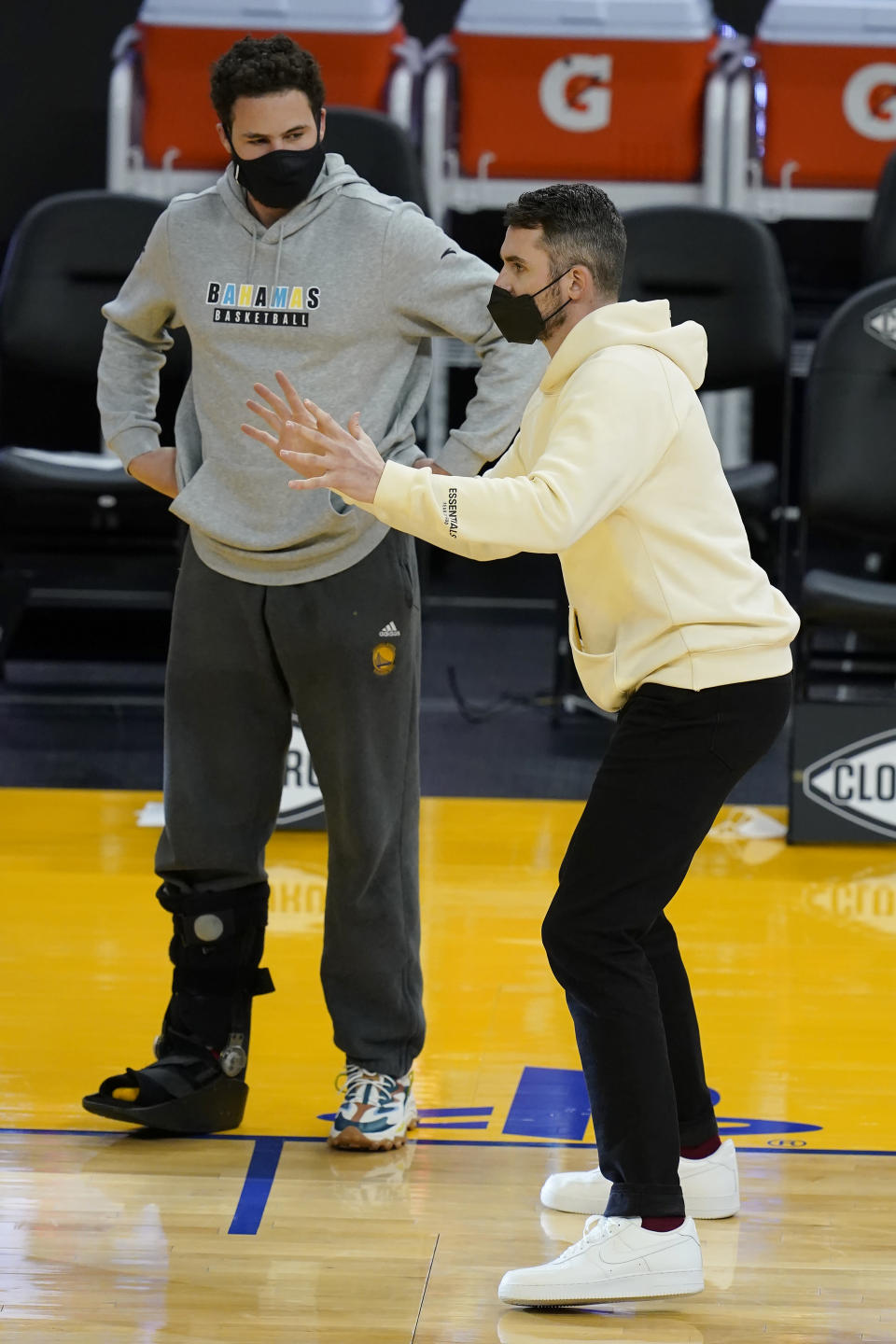 Golden State Warriors guard Klay Thompson, left, talks with Cleveland Cavaliers forward Kevin Love after the Warriors defeated the Cavaliers in an NBA basketball game in San Francisco, Monday, Feb. 15, 2021. (AP Photo/Jeff Chiu)