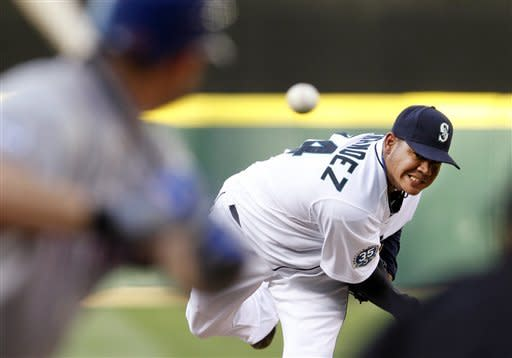 Seattle Mariners starting pitcher Felix Hernandez throws to Texas Rangers' Michael Young in the fifth inning of a baseball game Saturday, July 14, 2012, in Seattle. (AP Photo/Elaine Thompson)