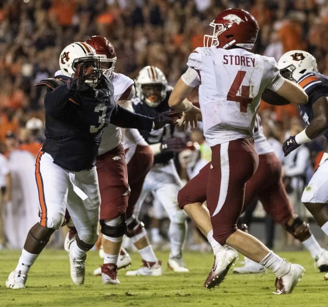 Auburn defensive lineman Marlon Davidson (3) pressures Arkansas quarterback Ty Storey (4) into an incomplete pass on third down during the first half of an NCAA college football game, Saturday, Sept. 22, 2018, in Auburn, Ala. (AP Photo/Vasha Hunt)