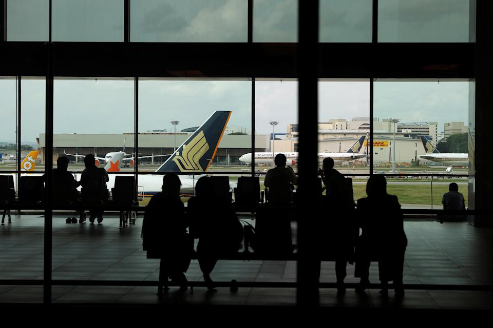 People look at a Singapore Airlines plane, amid the spread of the coronavirus disease (COVID-19), at a viewing gallery of the Changi Airport in Singapore October 12, 2020. REUTERS/Edgar Su