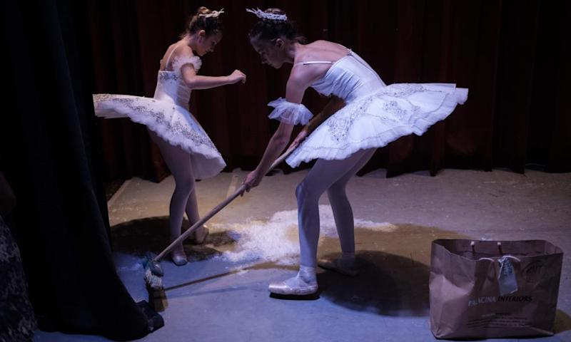 Members of the Dance Centre Kenya clean the stage during the intermission of a production of the Nutcracker.