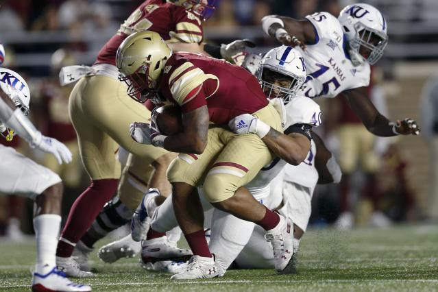 Kansas linebacker Dru Prox (40) tackles Boston College running back AJ Dillon (2) during the first half of an NCAA college football game in Boston, Friday, Sept. 13, 2019. (AP Photo/Michael Dwyer)