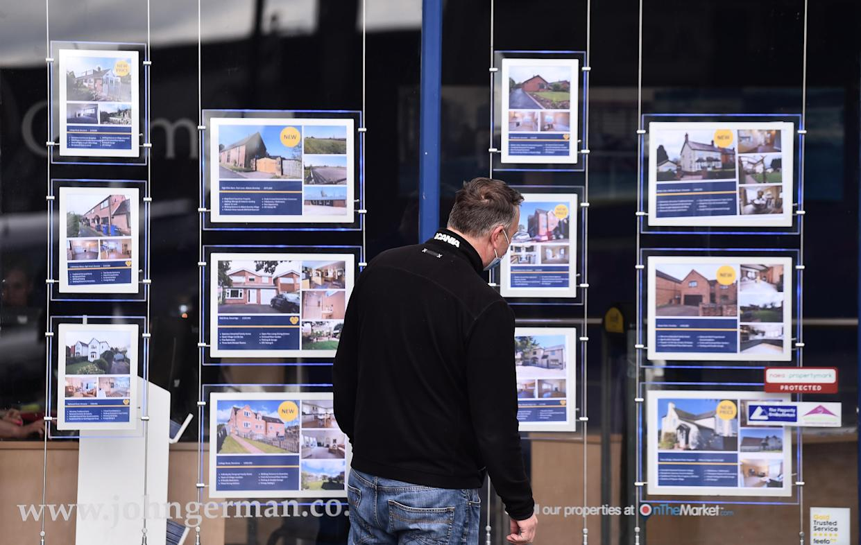 UTTOXETER-ENGLAND - MAY 05: A man is seen looking at houses for sale at an estate agents on May 05, 2021 in Uttoxeter, England . (Photo by Nathan Stirk/Getty Images) (Photo by Nathan Stirk/Getty Images)