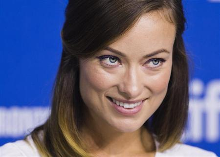 """Cast member Olivia Wilde speaks during the """"Third Person"""" news conference at the 38th Toronto International Film Festival in Toronto, September 10, 2013. REUTERS/Mark Blinch/Files"""