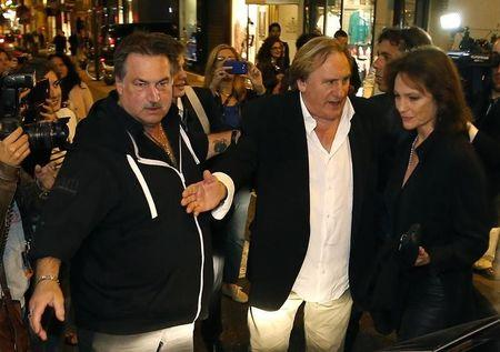 "Cast members Gerard Depardieu (C) and Jacqueline Bisset (R) arrive for the screening of the film ""Welcome to New York"" directed by Abel Ferrara at a movie theatre during the 67th Cannes Film Festival in Cannes May 17, 2014. REUTERS/Eric Gaillard"