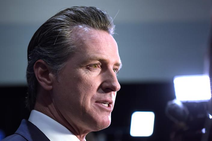 California Governor Gavin Newsom speaks to the press in the spin room after the sixth Democratic primary debate of the 2020 presidential campaign season co-hosted by PBS NewsHour & Politico at Loyola Marymount University in Los Angeles, California on December 19, 2019. (Photo by Agustin PAULLIER / AFP) (Photo by AGUSTIN PAULLIER/AFP via Getty Images) ORIG FILE ID: AFP_1N77A8
