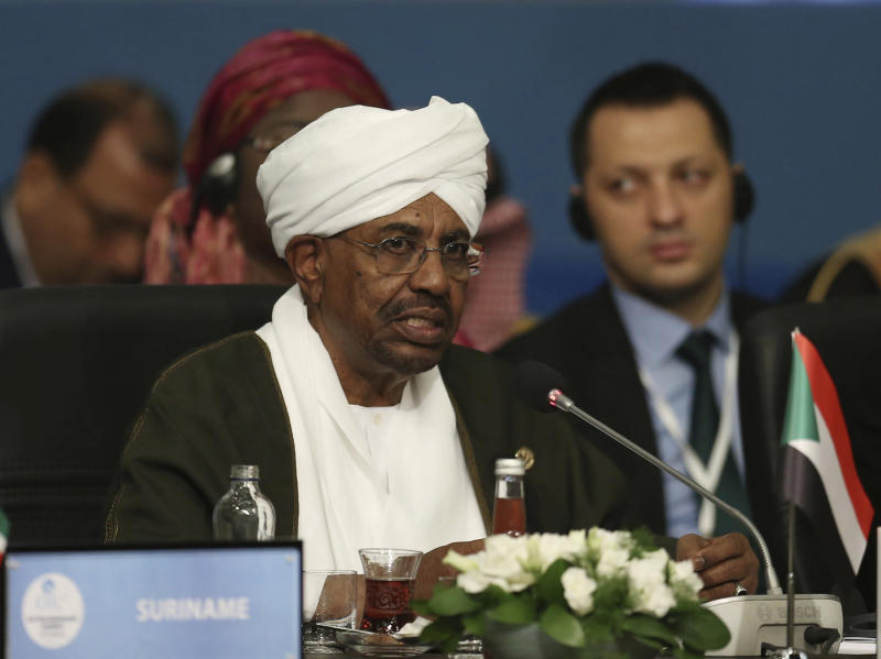 """FILE - In this May 18, 2018, file photo, Sudan's President Omar al-Bashir speaks during the extraordinary summit of the Organization of Islamic Cooperation (OIC), in Istanbul, Turkey. Sudan's armed forces were to deliver an """"important statement"""" and asked the nation to """"wait for it"""" on Thursday, April 11, 2019, state TV reported, as two senior officials said the military had forced longtime President Omar al-Bashir to step down.(Presidential Press Service/Pool via AP, File)"""
