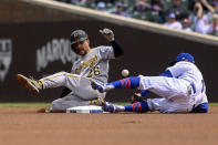 Pittsburgh Pirates Adam Frazier (26) slides safely into second base past Chicago Cubs infielder Eric Sogard (4) during the first inning of a baseball game, Saturday, May 8, 2021, in Chicago. (AP Photo/Matt Marton)