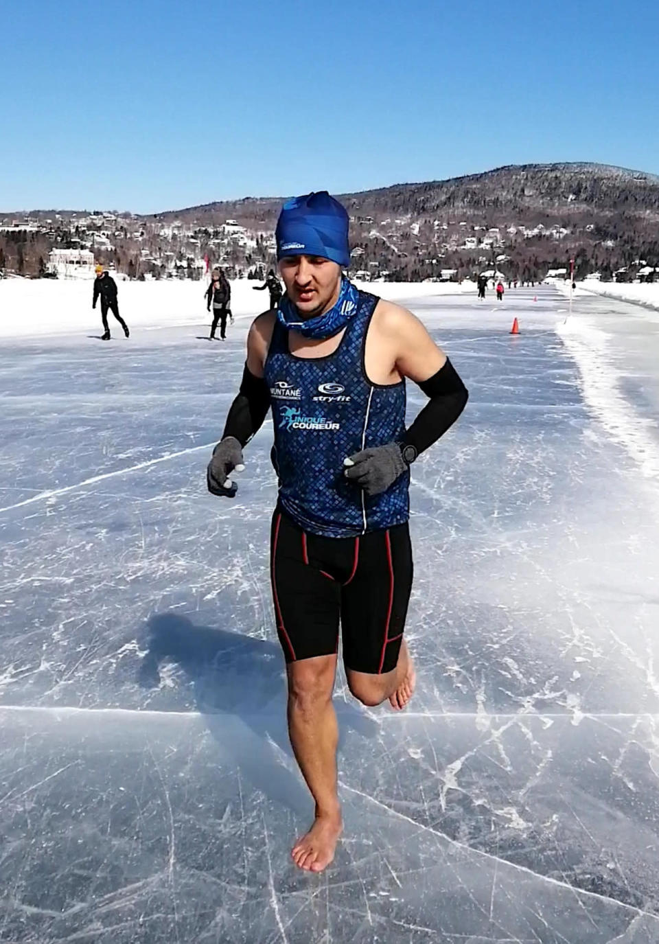 Barefoot sprinter races on frozen lake, sets unofficial world record